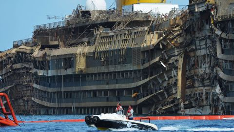 The ship had been lying on its side for 20 months off the island of Giglio. Here, members of the U.S. company Titan Salvage and the Italian marine contractor Micoperi pass by the wreckage.