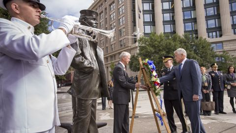 Defense Secretary Chuck Hagel, right, and Gen. Martin Dempsey, chairman of the Joint Chiefs of Staff, second from right, present a wreath at the Navy Memorial in Washington on September 17.