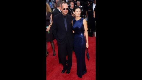 """Back when they were still together, Bruce Willis and Demi Moore made a sophisticated couple on the red carpet, as they did here at the 1997 Emmys. Moore's """"If These Walls Could Talk"""" was nominated for an Emmy."""