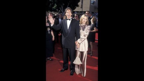 Actress Michelle Pfeiffer glowed next to TV powerhouse husband David E. Kelley at the 1995 Emmy Awards.