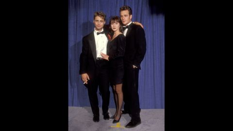 """The stars of """"Beverly Hills, 90210"""" -- (from left) Jason Priestley, Shannen Doherty and Luke Perry -- could've been mistaken as posing for a prom photo at the 1991 Emmys."""
