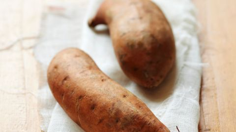 """<strong>Sweet potatoes:</strong> These veggies are for much more than Thanksgiving casseroles. They're more nutritionally dense than their white-potato counterparts. Try roasting them; they'll taste delicious, and you may maintain more vitamins than boiling. <br /><br />Health benefits include<br />• Excellent source of vitamin A <br />• Good source of iron <br />• Anti-inflammatory benefits <br /><br />Harvest season: September to December<br /><br /><a href=""""http://www.health.com/health/gallery/0,,20307221,00.html"""" target=""""_blank"""" target=""""_blank"""">Health.com: Eat this and burn more fat</a><br />"""