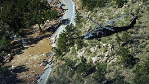 A Blackhawk helicopter flies over a canyon during a search around Boulder, Colorado, on September 17.
