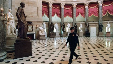 A police officer walks through the empty Statuary Hall in the Capitol on November 15, 1995.