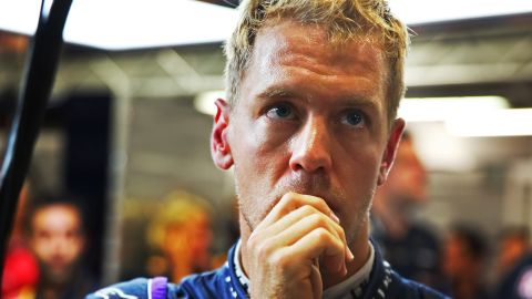 A pensive Sebastian Vettel waits to see if he has qualified in pole position for the Singapore Grand Prix at Marina Bay Street Circuit.