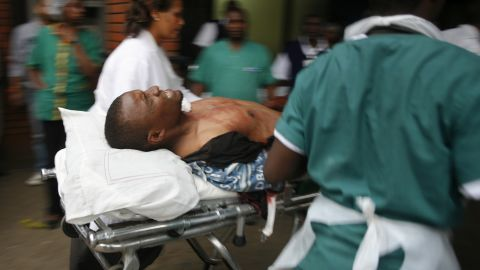 An injured man is wheeled into the Aga Khan Hospital in Nairobi.