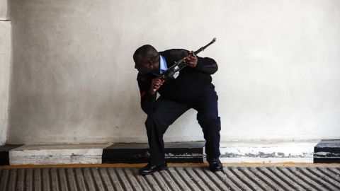 An armed official crouches on September 21.