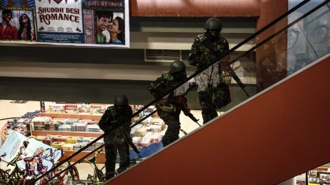 Soldiers move up stairs inside the Westgate Mall.
