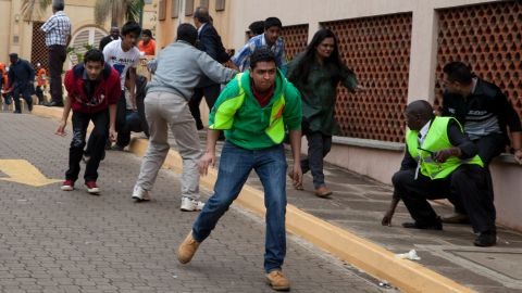 People run for cover outside the mall after heavy shooting started on September 23.
