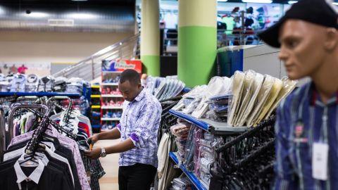 A customer browses men's clothing on display at the Nakumatt department store.
