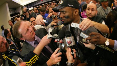 Charles Woodson of the Green Bay Packers fielded questions from a  mob of reporters in the locker room after winning Super Bowl XLV at Cowboys Stadium on February 6, 2011 in Arlington, Texas.