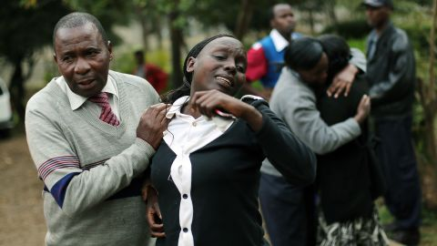 Relatives of Johnny Mutinda Musango, 48, weep after identifying his body at the city morgue  in Nairobi, Kenya Tuesday September. 24. Musango was one of the victims of the Westgate Mall hostage siege. Kenyan security forces were still combing the Mall on the fourth day of the siege by al-Qaida-linked terrorists.