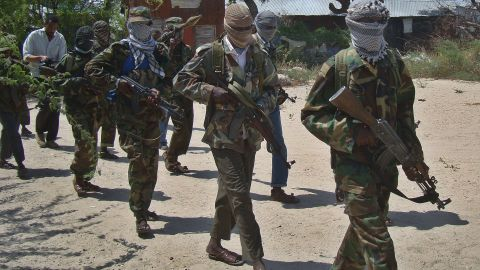 This file photo shows an Al-Qaeda linked al-shabab recruits walk down a street in 2012 in the Deniile district of the Somalian capital, Mogadishu, following their graduation.
