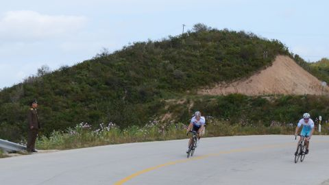 North Korean soldiers line the roads of the race.