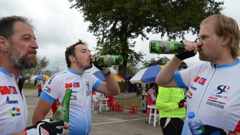 Norwegians and Swedes celebrating with local North Korean beer after reaching the finish line.