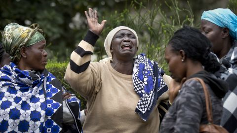 Mary Italo, center, grieves with other relatives for her son Thomas Abayo Italo, 33, who was killed in the Westgate Mall attack, as they wait to receive his body at the mortuary in Nairobi, Kenya Wednesday, Sept. 25, 2013