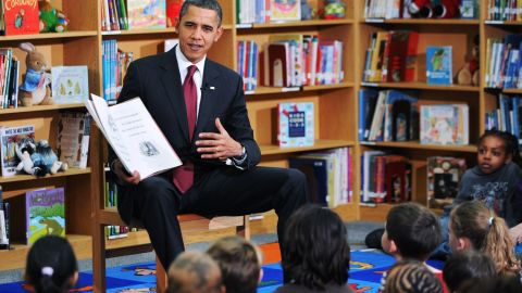 """President Barack Obama reads """"Night Before Christmas"""" to second graders at Long Branch Elementary School in Arlington, Virginia, in December 2010."""