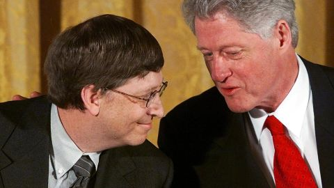"""Gates and former U.S. President Bill Clinton attend a White House conference on """"the New Economy"""" in April 2000."""