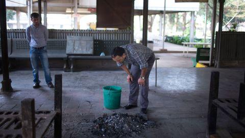 Manish Mashru looks at the ashes of his daughter Neha Mashru on September 26.