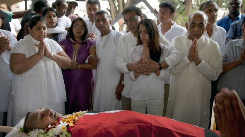 Family members pay their last respects at the funeral of Mitul Amritlal Shah at the Hindu Crematorium in Nairobi on September 26.