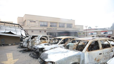 Burned out cars sit on the top of the structure.