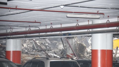 Some vehicles look unscathed on a lower level of the structure.
