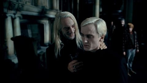 """Jason Isaacs, left, as Lucius Malfoy and Tom Felton as the mean and creepy Draco Malfoy in """"Harry Potter and the Deathly Hallows -- Part 1."""""""
