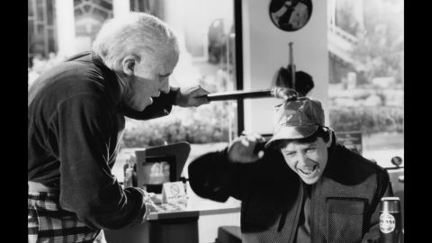 "Biff Tannen (Thomas F. Wilson) terrorizes Marty McFly Jr. (Michael J. Fox) in ""Back to the Future II."""