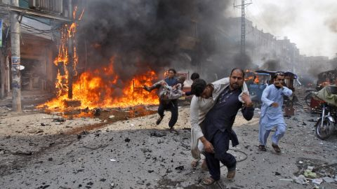 Injured victims are carried away after the blast.