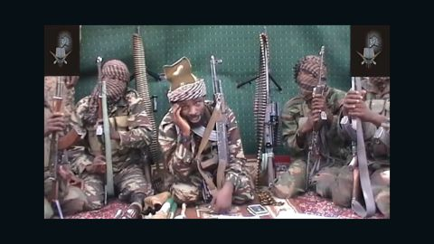 """A video of Abubakar Shekau, who claims to be the leader of the Nigerian Islamist extremist group Boko Haram, is shown in September 2013. Boko Haram is an <a href=""""http://www.cnn.com/2014/02/27/world/africa/nigeria-year-of-attacks"""">Islamist militant group waging a campaign of violence</a> in northern Nigeria. The group's ambitions range from the stricter enforcement of Sharia law to the total destruction of the Nigerian state and its government. Click through to see recent bloody incidents in this strife-torn West African nation:"""