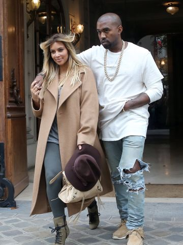 Kim kept a low profile following the arrival of the couple's daughter, North, in June 2013, but toward the end of that September she showed off both a new hair color and her post-baby physique in Paris as Kanye stayed close.