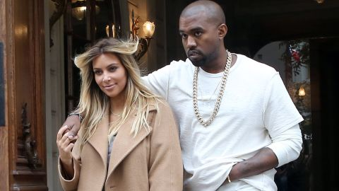 Kim kept a low profile following the arrival of the couple's daughter, North, in June, but toward the end of September she showed off both a new hair color and her post-baby physique in Paris as Kanye stayed close.