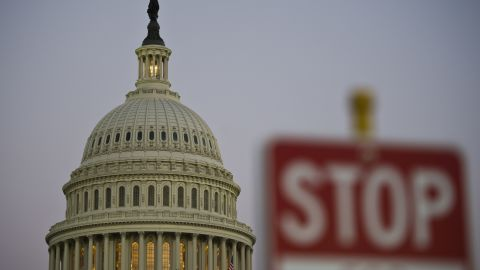 A stop sign is seen at dusk next to the US Congress building on the eve of a possible government shutdown as Congress battles out the budget in Washington, DC, September 30, 2013. AFP PHOTO/ MLADEN ANTONOV (Photo credit should read MLADEN ANTONOV/AFP/Getty Images)