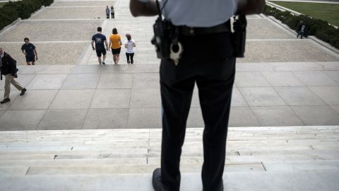 A U.S. park service police officer stands guard at the entrance of the closed Lincoln Memorial on October 1.