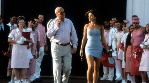 """Michael Caine walks with Bullock in a scene from the 2000 film """"Miss Congeniality."""""""