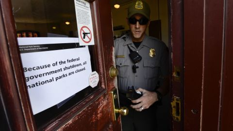 A National Park Service ranger finishes putting up a sign indicating all facilities at the Martin Luther King Historic Site are closed to the public in Atlanta, on October 1.