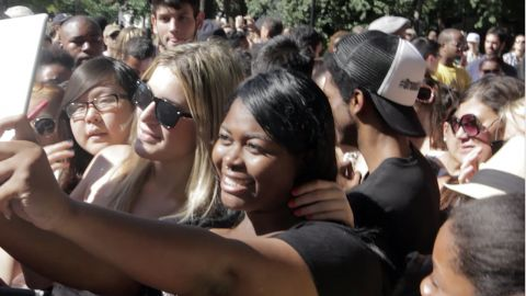 Popular Vine star Jessi Smiles poses for a tablet selfie with a fan.