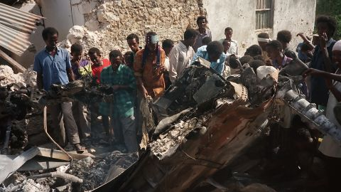 Somalis look at the wreckage of a U.S. helicopter in Mogadishu in October 1993.