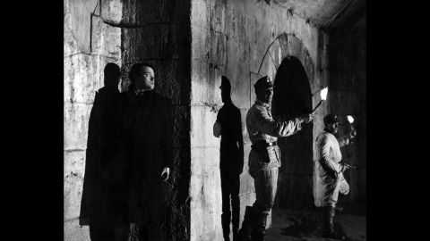 """In one of the great reveals in movie history, black market profiteer Harry Lime (Orson Welles) emerges from the shadows in """"The Third Man""""<strong> </strong>(1949). For much of the movie, Holly Martins (Joseph Cotten) and the audience believe Lime is dead."""