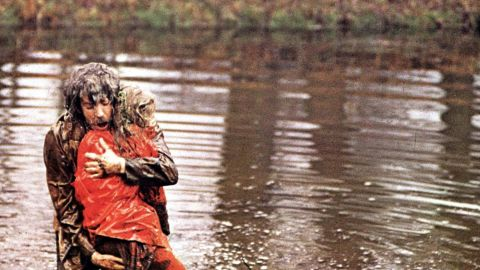 """In 1973's<strong> </strong>""""Don't Look Now,"""" a troubled couple (Donald Sutherland and Julie Christie) travel to Venice to escape the grief caused by the death of their daughter. Sutherland's character has visions of seeing his child in a red coat, but it's actually a serial killer -- and Sutherland's visions are actually about himself. The haunting film was directed by Nicolas Roeg."""