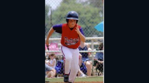 Garrett Buckelew playing baseball before being diagnosed.