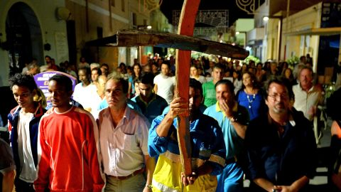 People attend the torchlight procession in memory of victims of the immigrant boat disaster on October 4, 2013 in Lampedusa, Italy.