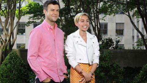 """Taran Killam and Cyrus pose in a promo for her upcoming """"Saturday Night Live"""" episode on October 5."""