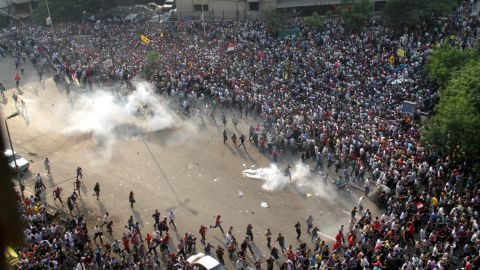 Morsy supporters run from tear gas along a street in downtown Cairo on October 6.