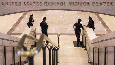 Officers stand at the base of stairs leading to the Capitol Rotunda on Monday, October 7.