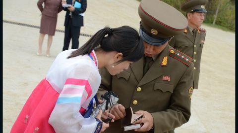 Custom official and tourist bureau guide checking foreigners' passports.