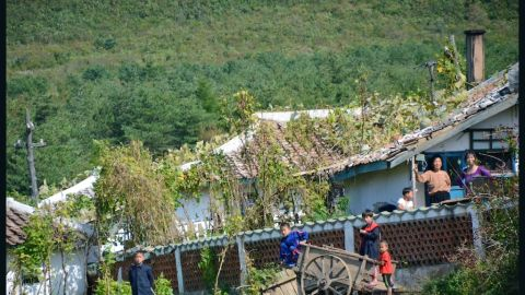 Kids playing outside village houses.