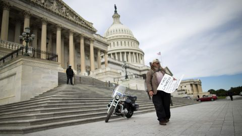 """Rick Hohensee holds a """"Fire Congress"""" sign near the House steps on Capitol Hill in Washington on Tuesday, October 8."""