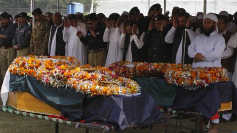 People attend funeral prayers for victims of an explosion in Peshawar, Pakistan, Monday, October 7, 2013. A bomb exploded next to a van carrying Pakistani security guards tasked with protecting workers involved in an anti-polio drive in the country's northwest on Monday.