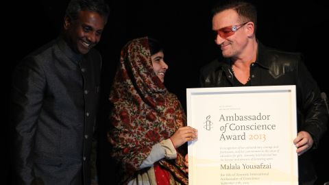 Musician Bono, right, and Salil Shetty, the secretary general of Amnesty International, honor Malala with the Amnesty International Ambassador of Conscience Award at the Manison House in Dublin, Ireland, in September 2013. The award is Amnesty International's highest honor, recognizing individuals who have promoted and enhanced the cause of human rights.